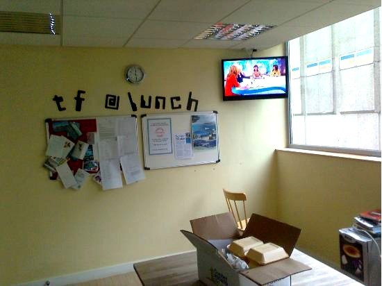 Corner mounted TV in lunchroom in Belfast City centre, installed by Aerial Installations and Services, Northern Ireland