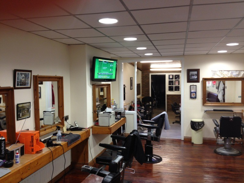 Wallmounted TV in barber's shop fitted by 1st Aerial Installations & Services,Falls Road, Belfast, Northern Ireland